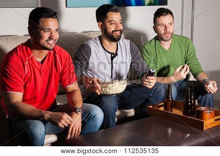 Friends Watching A Movie At Night