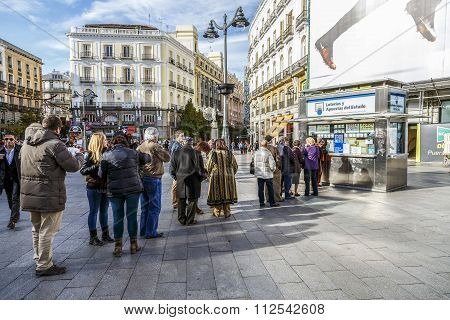 MADRID SPAIN - November 26 2015: typical Christmas queues to buy national lottery in the famous Puerta del Sol