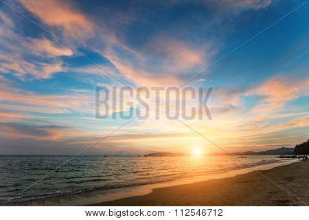 Tropical sunset on the lonley beach. Ao-Nang. Krabi. Thailand