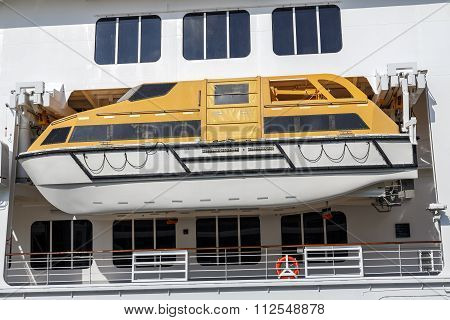 Safety lifeboat on deck of a cruise ship in genove