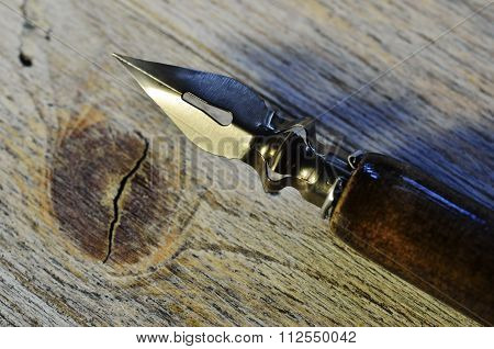 closeup of fountain pen on wooden background