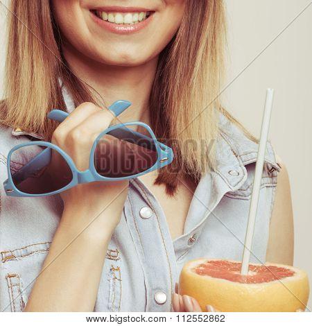 Flirty Woman Holding Sunglasses And Grapefruit