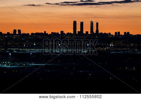 Madrid City Skyline In The Evening, Showing Barajas Airport Views At Night