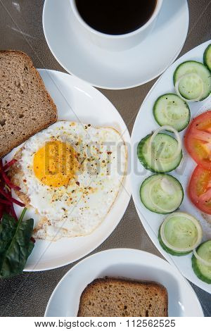 Coffee cup, scrambled eggs and salad