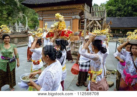 Balinese making preparation for praying during religious ceremony