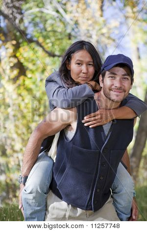 Young Couple In Fall Forest