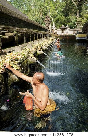 Balinese People Praying At Holy Spring Water At Pura Tirtha Empul.