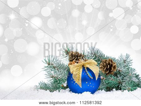 Christmas Baubles And Blue Balloon Over Snow Bokeh Background