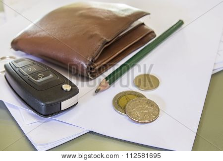 Black Car Key And Money On A White Paper