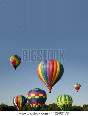 Hot-air Balloons Ascending Or Launching At A Ballooning Festival