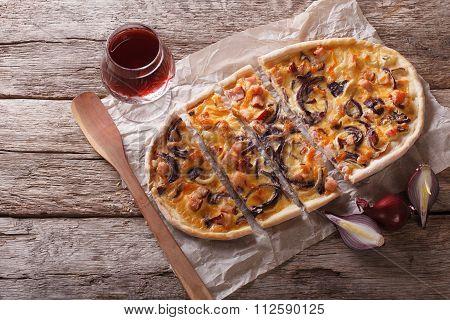 Sliced  Tarte Flambee And Red Wine. Horizontal Top View