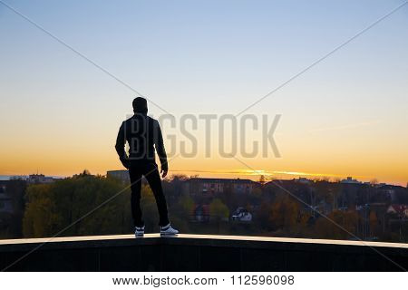 Yang Man Standing On The Roof
