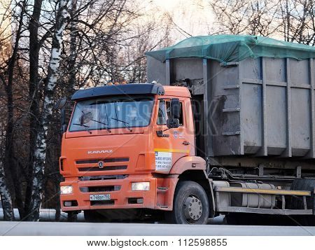 Moscow region, Russia, December, 27, 2015: The image of garbage truck on a highway in Moscow region