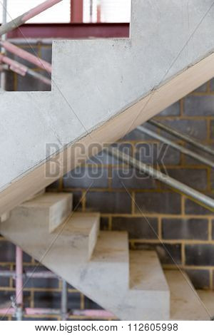 A Construction Site With Concrete Stairs And Scaffolding