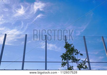 Transparent baffle against the blue sky