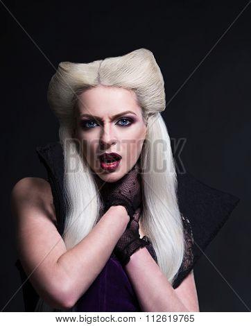 Beautiful blonde girl vampire