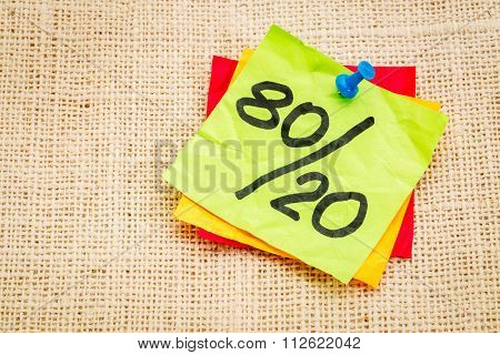 Pareto principle or eighty-twenty rule represented on a sticky note - a reminder or advice