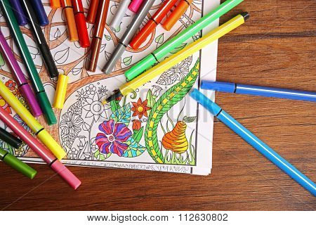 Coloured antistress book and soft tip pencils