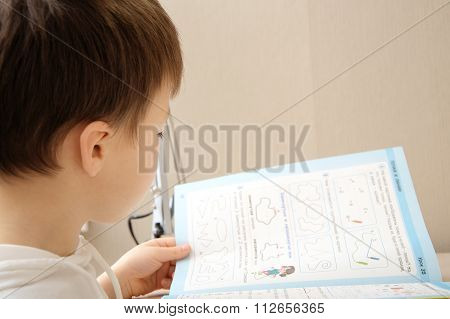 Boy Looking At The Book