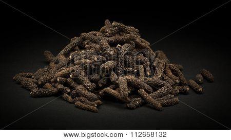 Pile of Organic Long pepper (Piper longum)