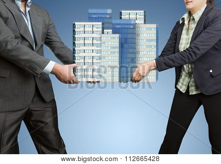 Businesspeople holding in their hands big office buildings