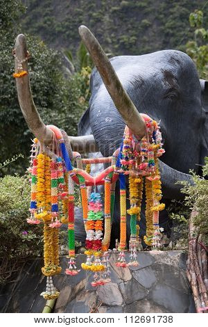 Elephant statue with oblations on a rock in Thailand
