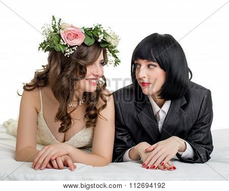 Studio photo of girls dressed as bride and groom
