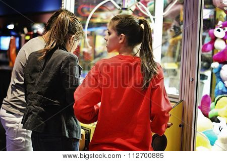 Girls in the crane machine