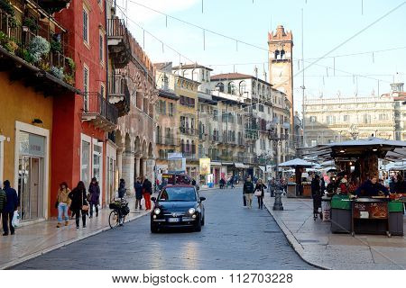 Verona, Italy - December 15: The View Of The Piazza Delle Erbe And Tourists On December 15, 2015 In