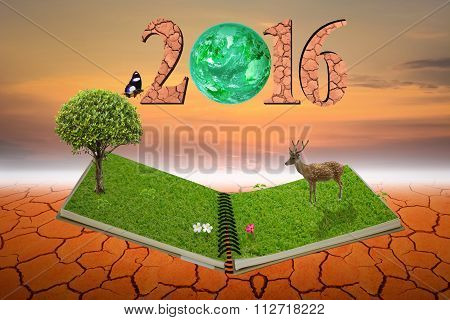 Open notebook nature in 2016 text On dry ground and with sky