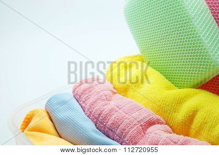 Colorful microfiber towel/cloth for car wipe with sponges in plastic box, gray background.