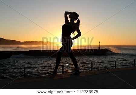 Silhoutte of a dancer against the rising sun