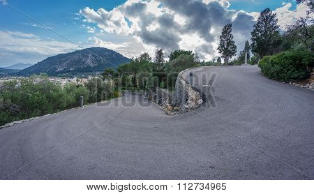 Ultra wide angle view of mountain hairpin bend curved road