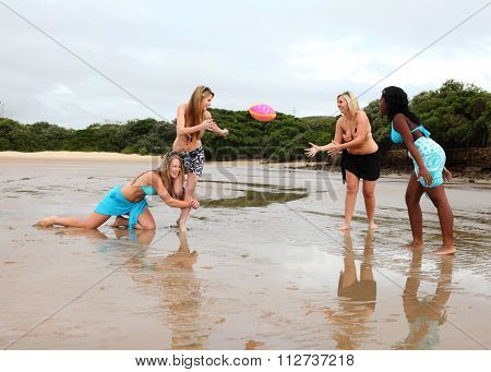 Four Girls Playing Beach Rugby