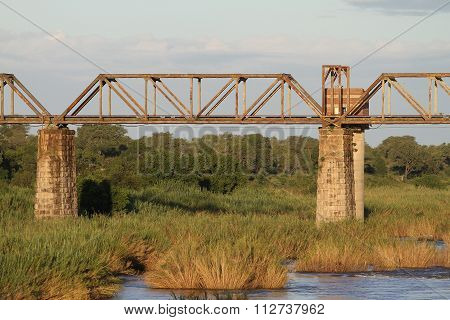 Old Bridge Over A River In Africa