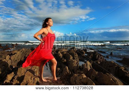 Brunette Soaking Up The Sun On The Beach