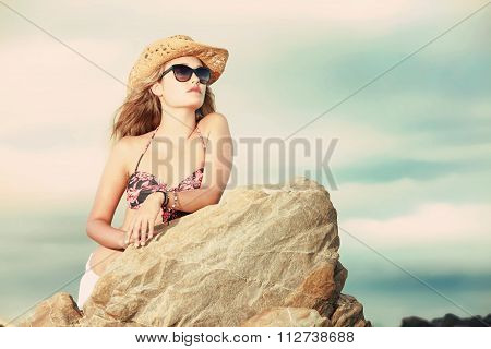 A Beautiful Blonde With Hat And Sunglasses Staring Into The Distance