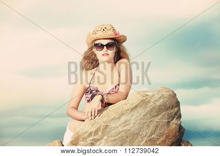 Attratctive Blonde Lady With A Cowboy Hat And Sunglasses