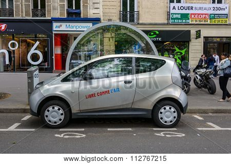 PARIS, FRANCE - CIRCA MAY 2013: An Autolib' is parked at an Autolib' station and charging point. Autolib' is an electric car sharing service.
