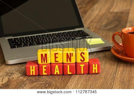 Mens Health written on a wooden cube in a office desk
