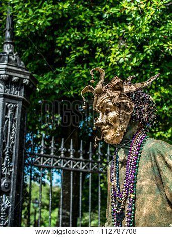 New Orleans French Quarter Street Performer in Mardi Gras Mask