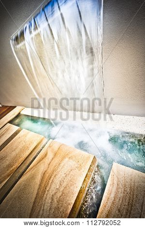 A Picture Of  A Pool With Water Droping From Wall