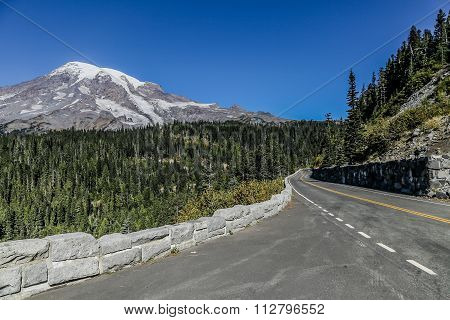 Mount Rainier and road through the park on a blue sky day