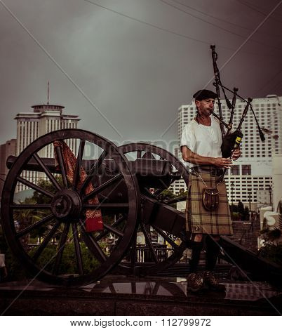 Silhouette of New Orleans Bagpipe Player and Cannon