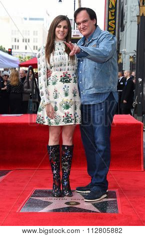 LOS ANGELES - DEC 21:  Quentin Tarantino & Courtney Hoffman arrives to the Walk of Fame honors Quentin Tarantino  on December 21, 2015 in Hollywood, CA.