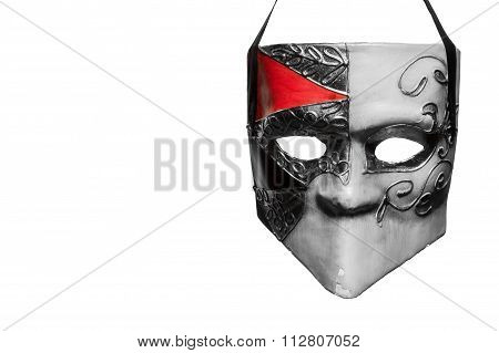 Venetian style masquerade mask in black and white with a bit of red hanging in front of a white background poster