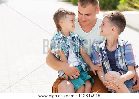 Happy young father with his two sons