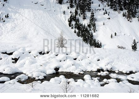 Mountain creek in winter
