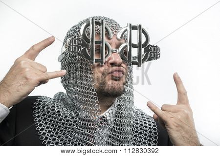 bank, businessman with medieval executioner in metal and silver glasses. concept of protection of savings and money