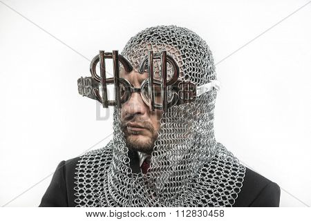 prosperity, businessman with medieval executioner in metal and silver glasses. concept of protection of savings and money